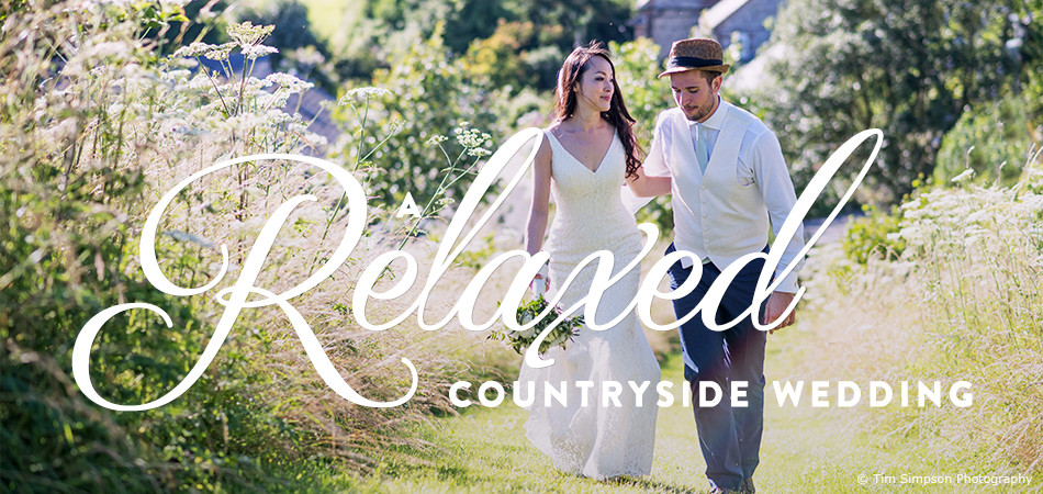The bride and groom walk through the beautiful Sussex countryside