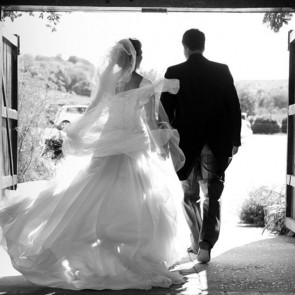 Newlyweds enter the Courtyard at Upwaltham Barns