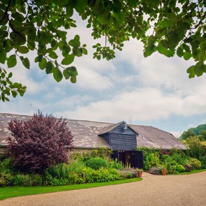 The barns and gardens at Upwaltham Barns wedding venue in Sussex