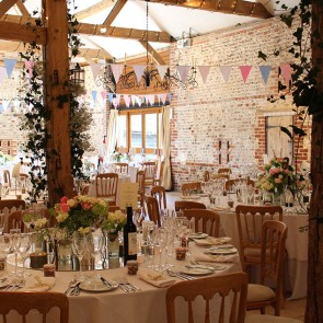 Bunting in the South Barn at Upwaltham Barns wedding venue in Sussex