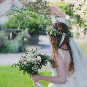 A boho bride in her flower crown at the country wedding venue in Sussex