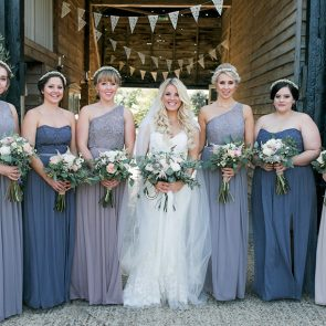 Bridesmaids wear blue and grey for a wedding at Upwaltham Barns