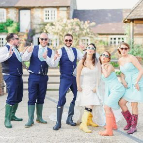 Bridesmaids and ushers have fun in the courtyard at Upwaltham Barns