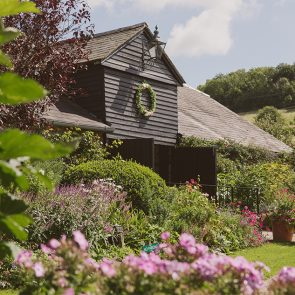 The East Barn is surrounded by spring flowers