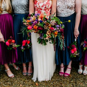 Vibrant flowers add colour to a wedding at Upwaltham Barns in Sussex