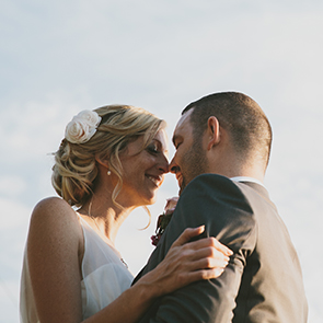 Bride and groom in the outdoor space at Upwaltham Barns