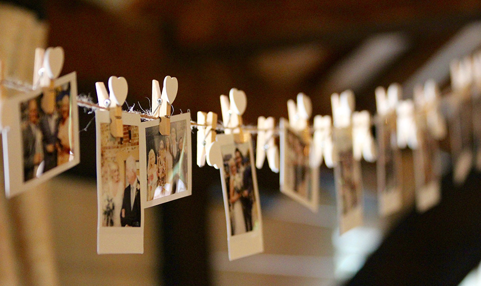 Photos of bride and groom hung on string