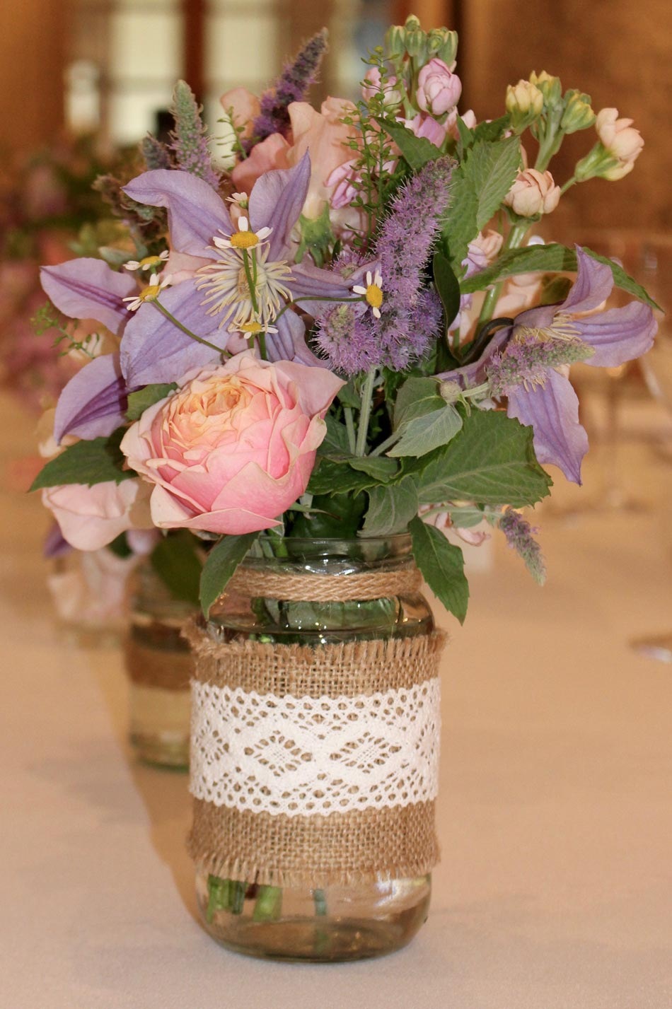 Purple flowers in a laced vase