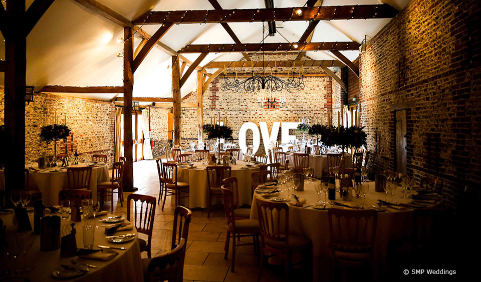 Set up for a wedding reception at Upwaltham Barns © SMP Weddings