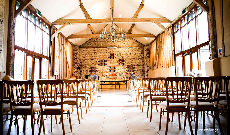 Set up for a wedding ceremony at Upwaltham Barns © SMP Weddings
