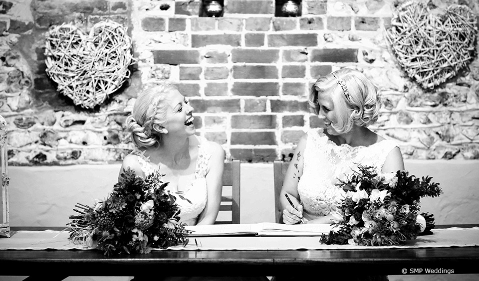 Signing the register at Hannah and Lauren's Upwaltham Barns Wedding © SMP Weddings