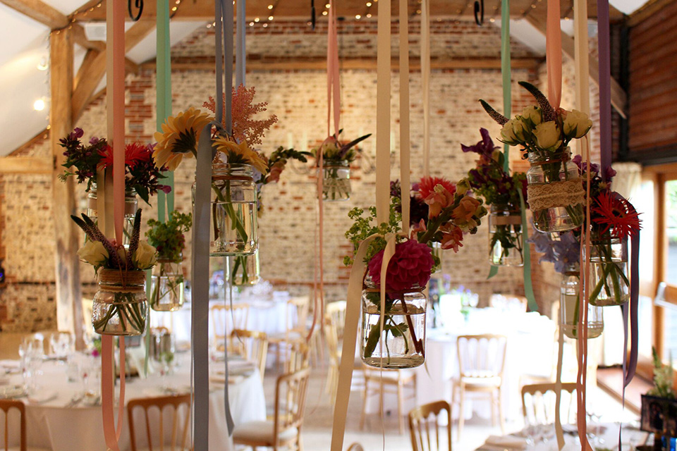 Rustic, charming and fun, these hanging lanterns make the most amazing wedding reception decorations for Upwaltham Barns