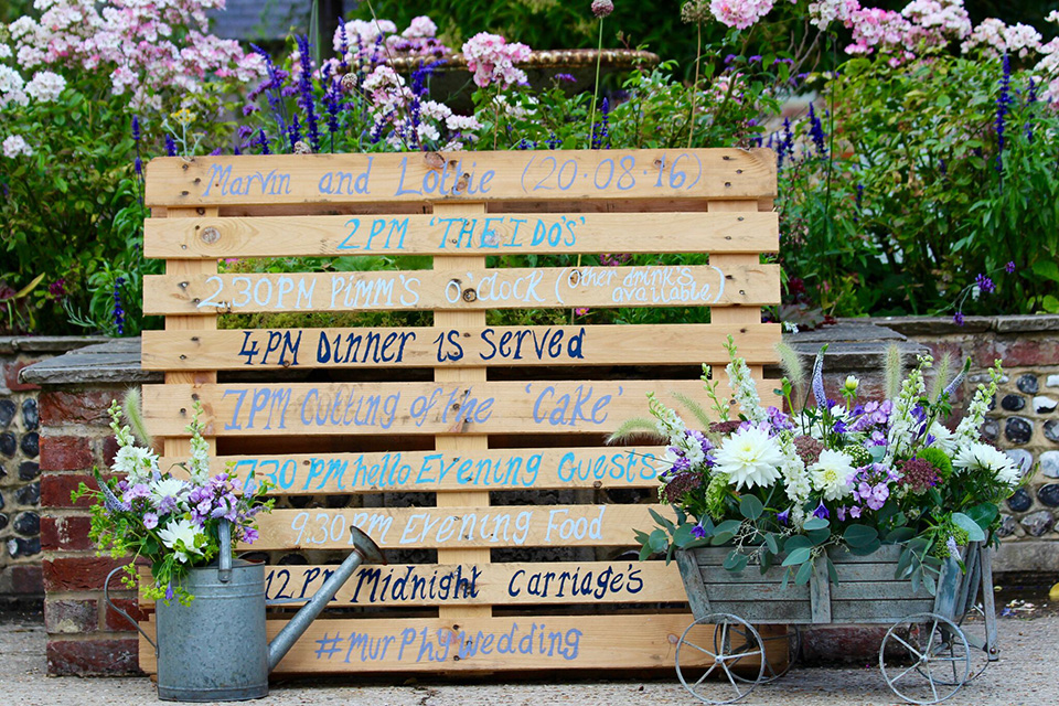 Wooden pallets look right at home in the country barn wedding venue