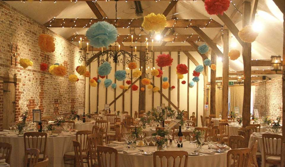 4. If you're looking for quirky wedding decorations, pompoms are fun and colourful. They look great at this barn wedding venue in West Sussex