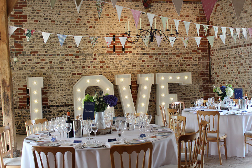 Light up this country barn wedding venue with stunning 'love' letters