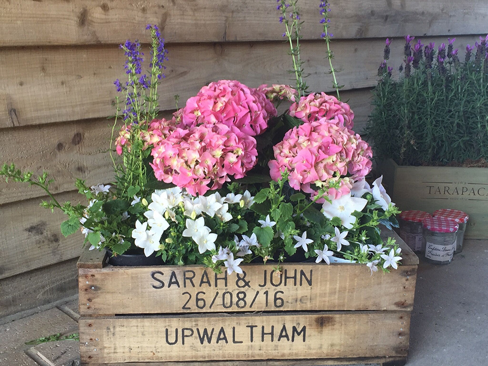 6. Celebrate your country surroundings at this wonderful West Sussex wedding venue and decorate with plenty of flowers and personalised planters