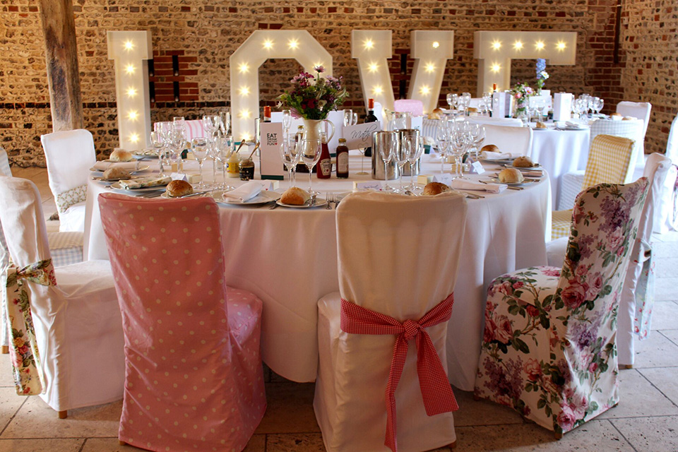 Add a touch of vintage to your wedding decorations at Upwaltham Barns with charming chair covers