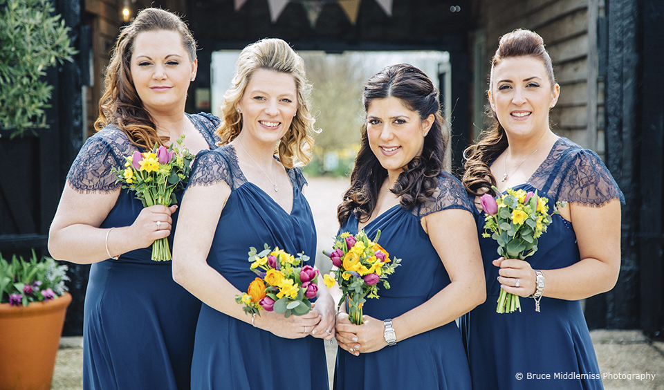 Bridesmaids outside of Upwaltham Barns before the wedding