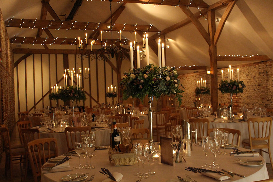 Candles and candelabras will turn this breathtaking barn wedding venue into an enchanting and inviting space