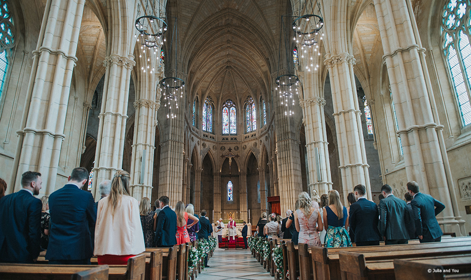 Couple getting married in a local cathedral