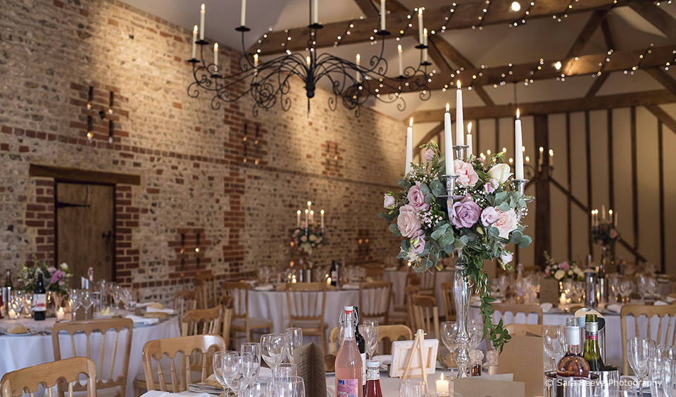 Elegant candelabra's decorated with dusty pink roses to create beautiful wedding centrepieces – wedding flowers