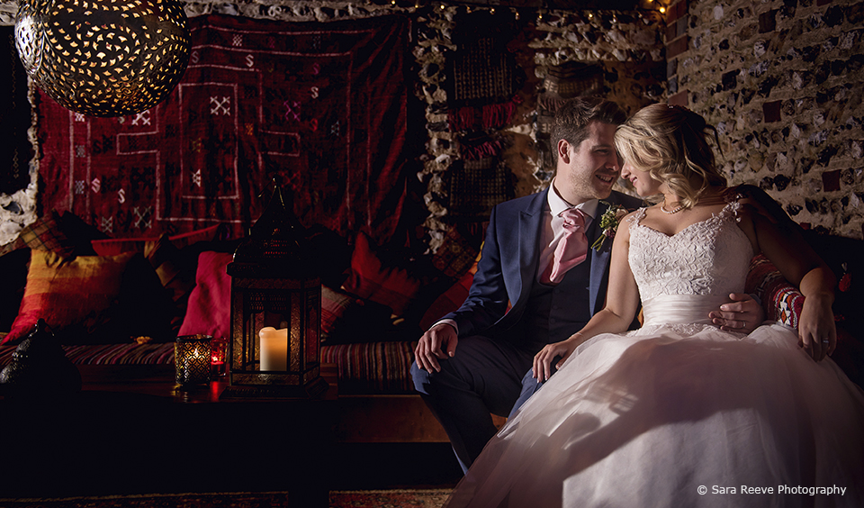The couple enjoy a romantic moment in the Moroccan snug at Upwaltham Barns