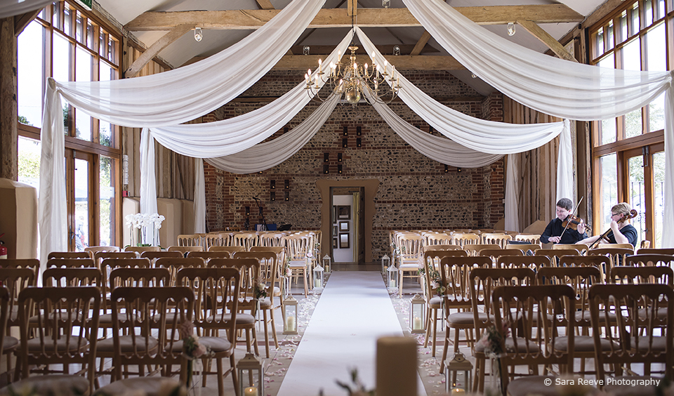 A beautiful barn venue set up and ready to welcome guests for a spring wedding ceremony
