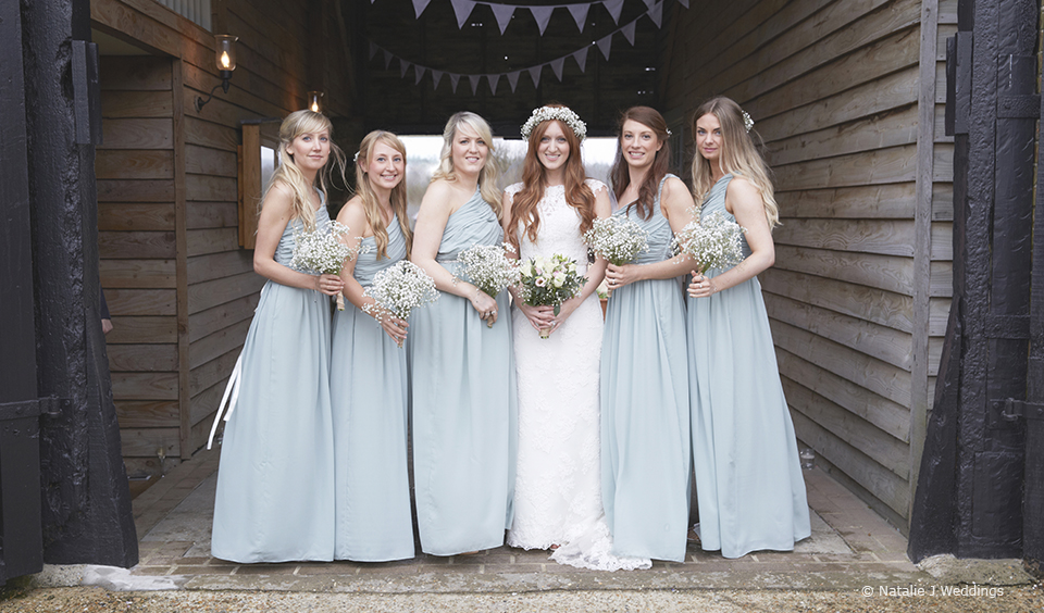 The bride and her bridesmaids at the beautiful Upwaltham Barns wedding venue in Sussex