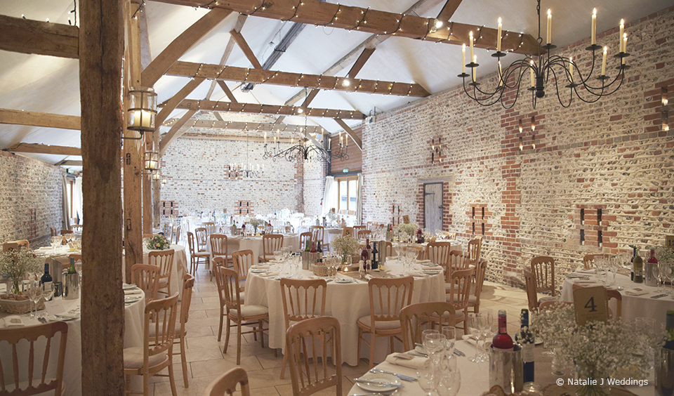The rustic South Barn is set up for a country wedding reception – wedding ideas