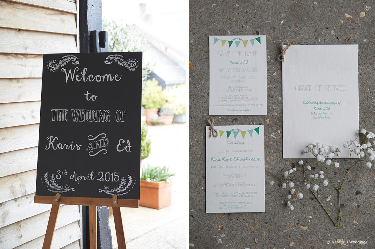 Simple wedding signs greet guests arriving for the ceremony at Upwaltham Barns in Sussex