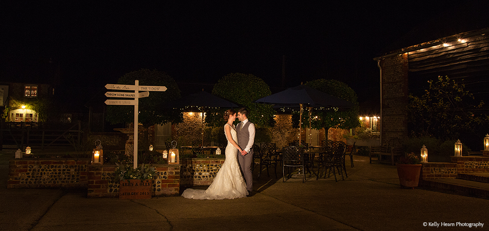 The bride and groom take a moment away from their guests in the beautiful Courtyard and Gardens