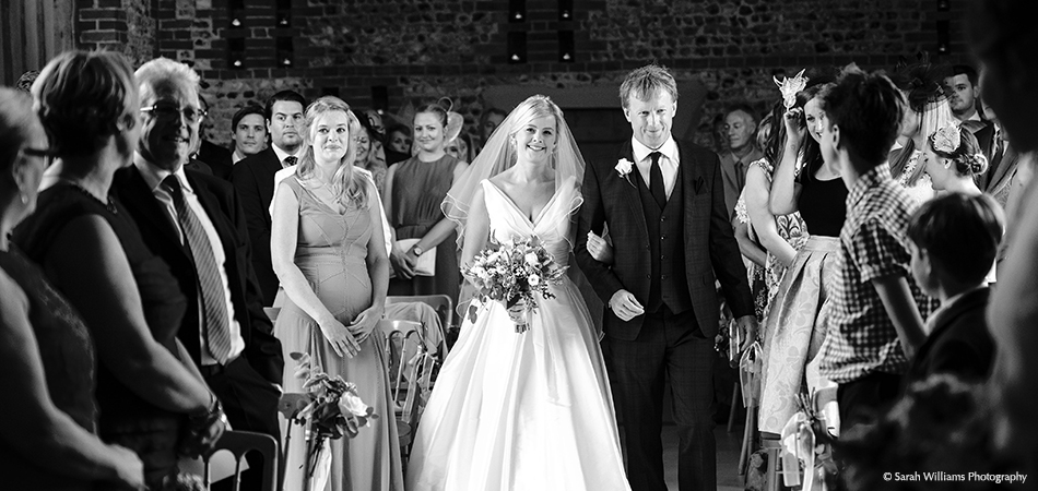 Civil ceremonies wedding barns west sussex the stunning bride walks down the aisle ready for the civil ceremony at uplwaltham barns junglespirit Gallery
