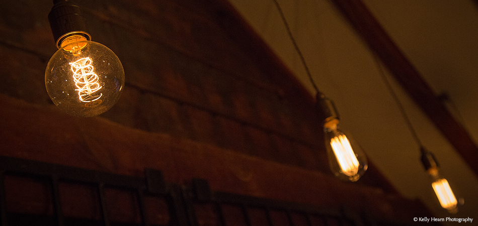 Set the ambience with cosy lighting inside The Stable Bar at Upwaltham Barns wedding venue