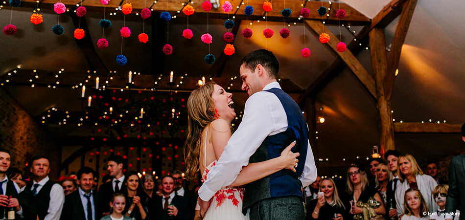 Newlyweds enjoy their first dance in the South Barn at the Sussex wedding venue