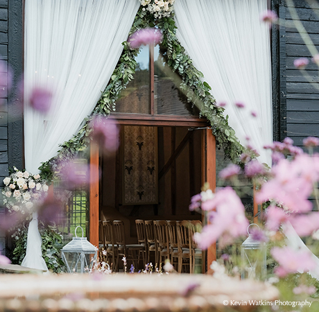 The beautiful East Barn venue set up and ready to welcome guests for a wedding ceremony