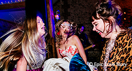 Wedding guests dance the night away at an evening wedding reception at Uplwaltham Barns in Sussex