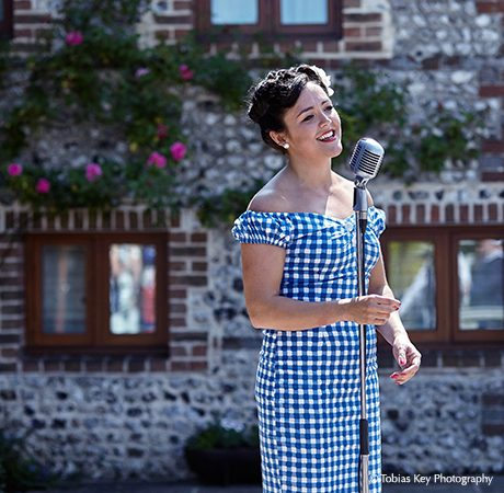 A 50's inspired wedding singer hosts a great performance that the Sussex wedding venue