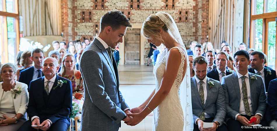 Emotions run high as the bride and groom say their wedding vows at a civil ceremony at Uplwatham Barns