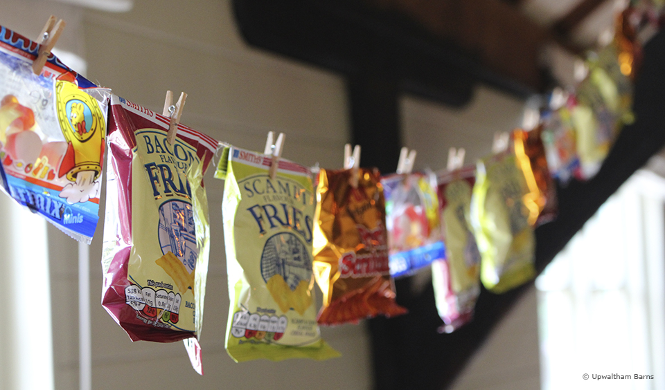 For an alternative to traditional bunting hang a selection of crisps and sweets for your guests to enjoy
