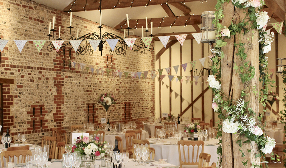 Beautiful floral bunting adds a pop of colour to a country wedding in the South Barn at Upwaltham Barns