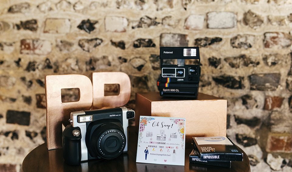 A simple polaroid guestbook was a hit with wedding guests at this stunning barn wedding venue