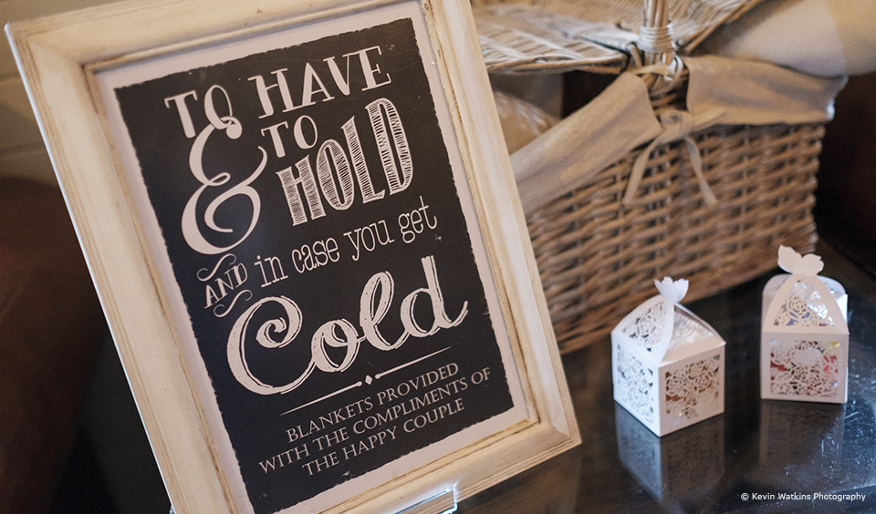A quirky wedding sign invites guests to use a blanket in the Morrocan Snug at Upwaltham Barns