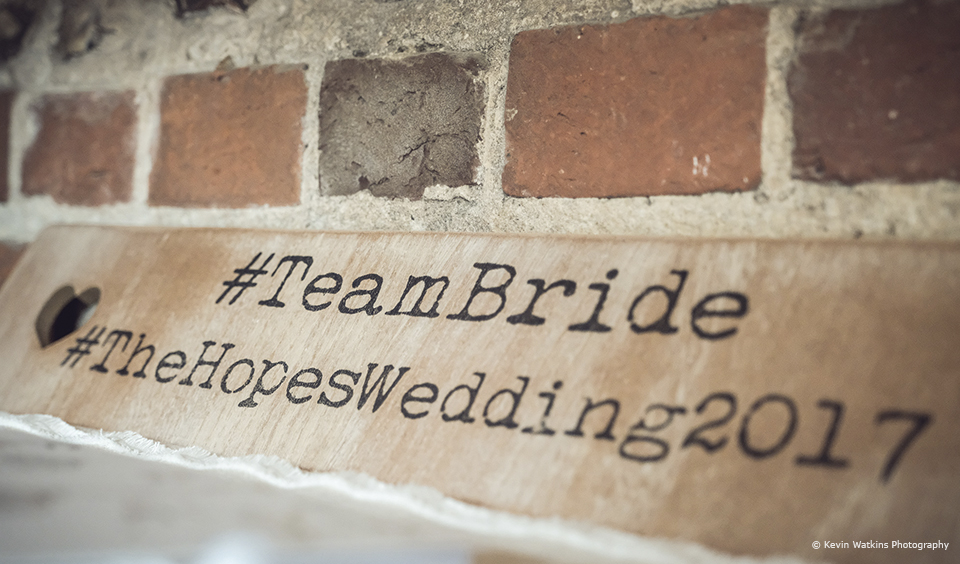 Use a wooden hashtag sign to encourage wedding guests to share wedding photos from your wedding at Upwaltham Barns
