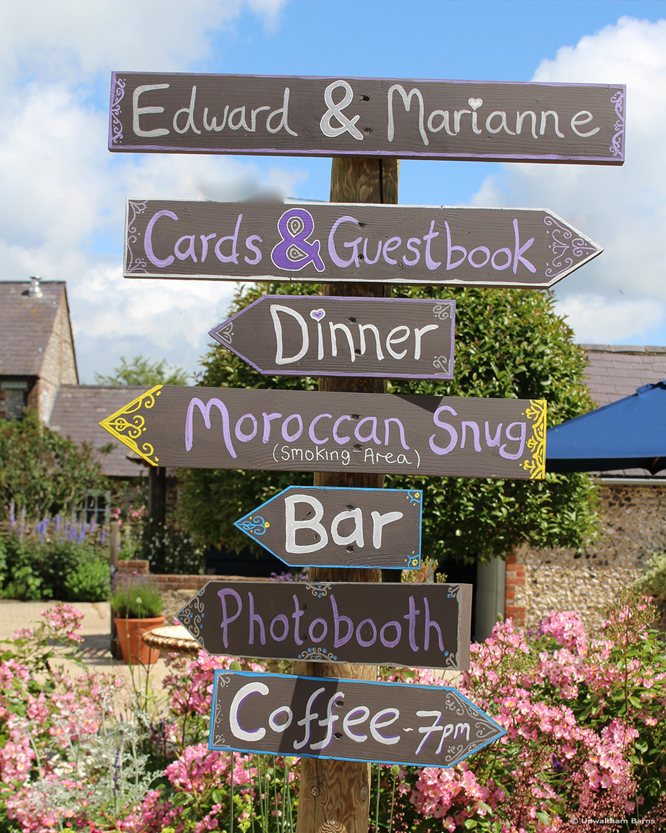 Guide your guests around Upwaltham Barns wedding venue in Sussex with signposts – wedding ideas
