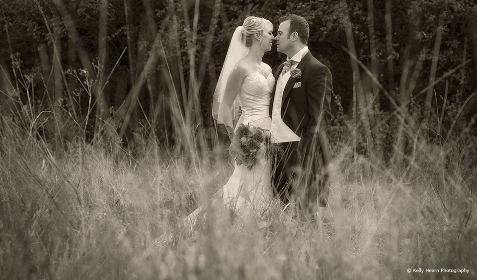 The bride and groom enjoy the countryside that surrounds Upwaltham Barns in Sussex