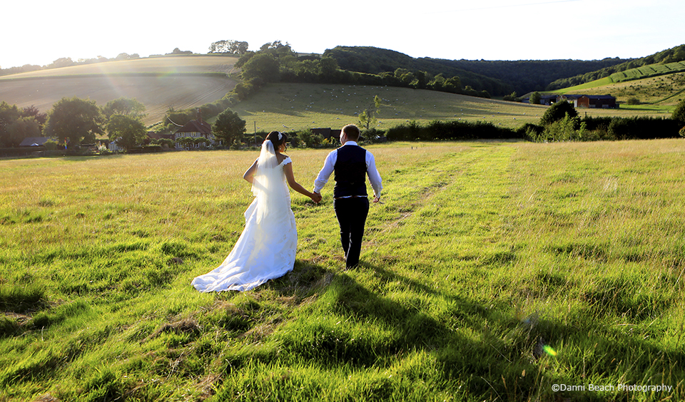 The bride and groom enjoy the Sussex countryside that surrounds Upwaltham Barns