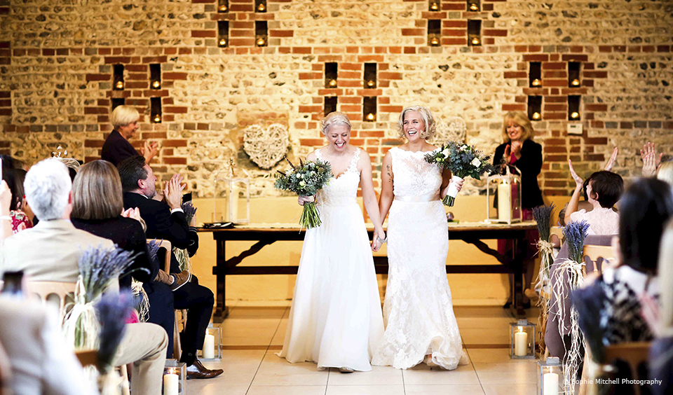 Brides enjoy their wedding ceremony at Upwaltham Barns in Sussex