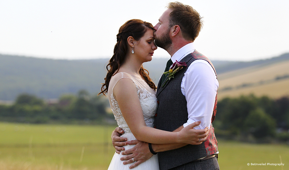 Husband and wife enjoy a moment after their ceremony at Upwaltham Barns in Sussex