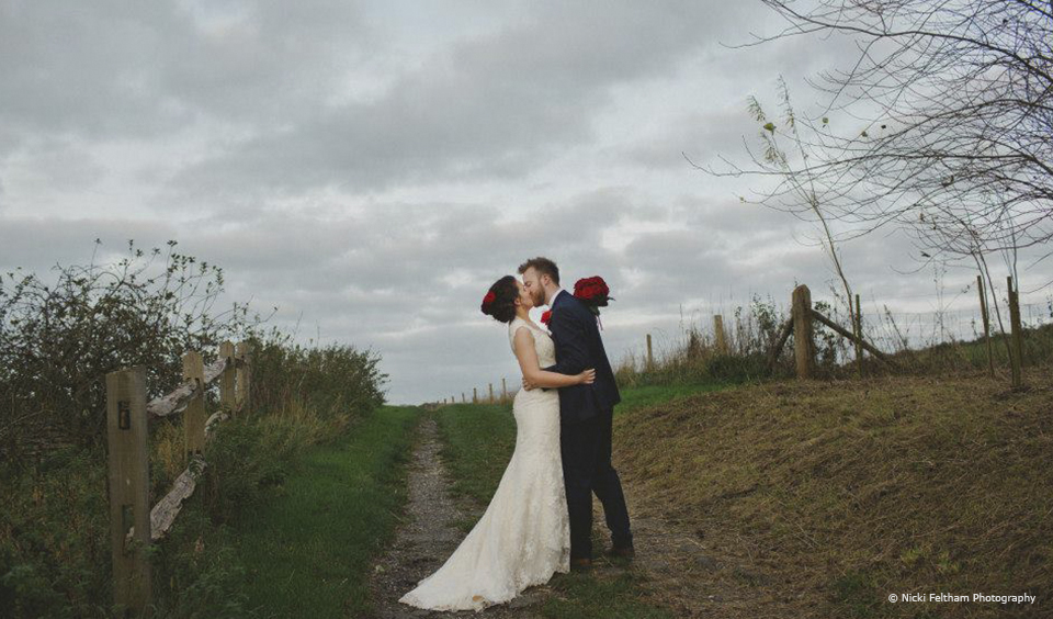 The new husband and wife in the Sussex countryside surrounding Upwaltham Barns