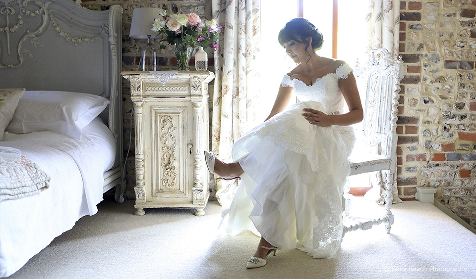 The bride gets ready in the Jasmine Cottage at this Sussex wedding venue